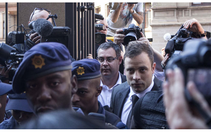 Oscar Pistorius arriving under heavy police guard at the High Court in Pretoria ahead of the second day of judgment in his murder trial on 12 September 2014. Picture: Christa Eybers/EWN