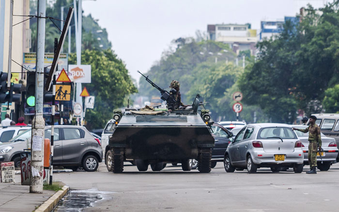 An armoured personnel carrier of the Zimbabwean military stands at an intersection. Picture: AFP.
