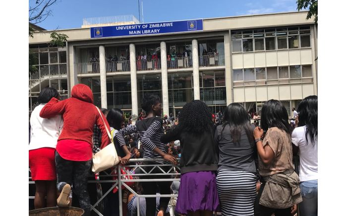 Students outside main library of the University of Zimbabwe calling for the chancellor to be fired.  Picture: Masechaba Sefularo/EWN