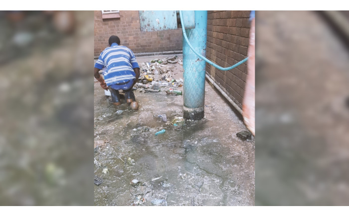 Plumbers unblocking pipes that have been clogged with raw sewage in the old Johannesburg central fire station. Picture: Supplied