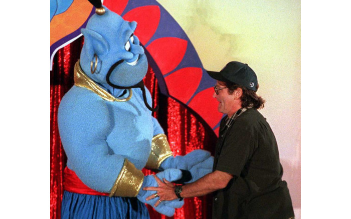 """Actor-comedian Robin Williams dances 10 July 1996 in Los Angeles with the Disney character """"Genie"""" during a celebration for the scheduled 13 August world release of the film """"Aladdin and the King of Thieves"""". Picture: AFP."""