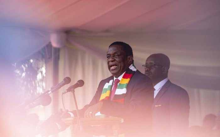 Zimbabwean President Emmerson Mnangagwa addresses mourners at the funeral ceremony.