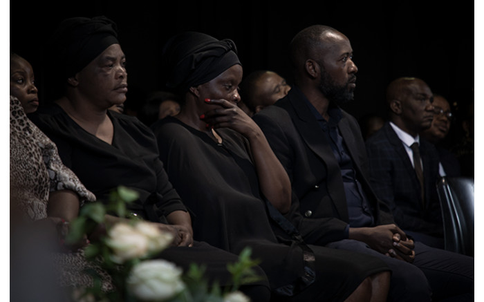 Enock Mpianzi's parents with other family members on stage. Xanderleigh Dookey/EWN