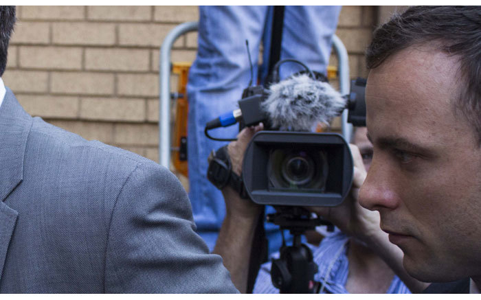 Oscar Pistorius arriving at the High Court in Pretoria under heavy media presence and police guard on 11 September 2014. Picture: Christa Eybers/EWN.