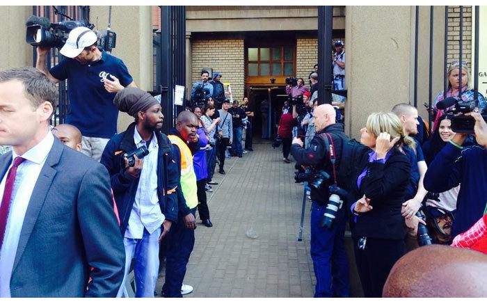 Media wait outside the High Court in Pretoria ahead of oscar Pistorius murder trial on 11 September 2014. Picture: Mandy Wiener/EWN.
