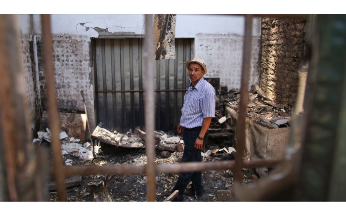 Barend Salomo stands in the middle of what used to be his butchery. Picture: Bertram Malgas/EWN