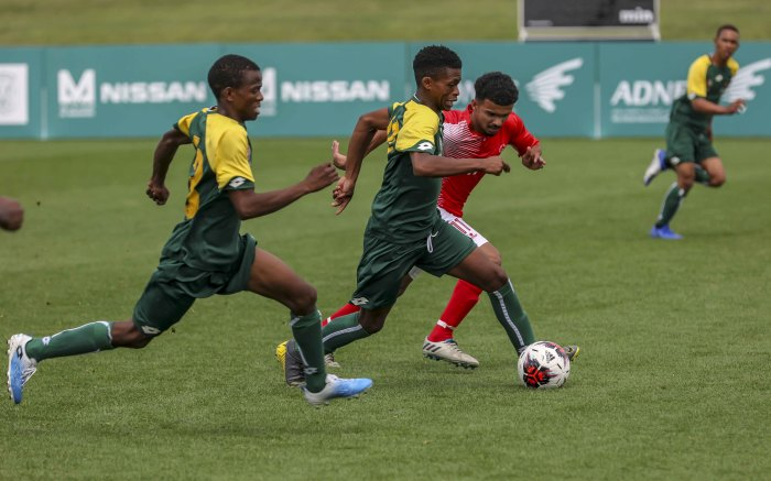 South African footballers speed down the field challenged by a UAE opponent. SA lost 4-0. Picture: Thomas Holder/EWN