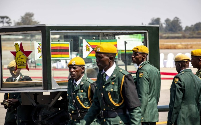 Presidential duard alongside the ceremonial coffin on the Robert Mugabe Airport strip.