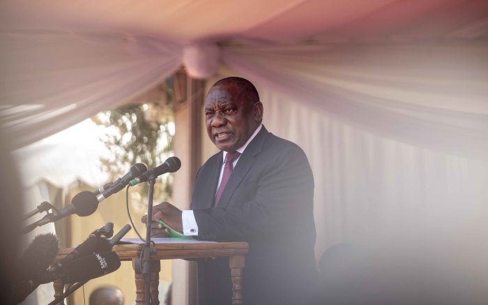South Africa's Cyril Ramaphosa addresses a booing crowd while making his dedication to Robert Mugabe.