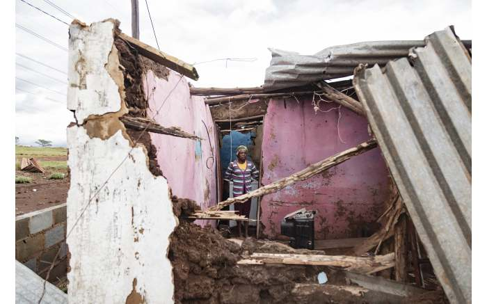Homeowners try to rebuild their homes after the Empolweni area in Pietermaritzburg was hit by a tornado. Picture: Sethembiso Zulu/EWN