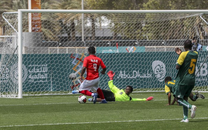 A UAE forward takes a shot at goal during their game with SA. The goal was stopped but SA still lost 4-0.