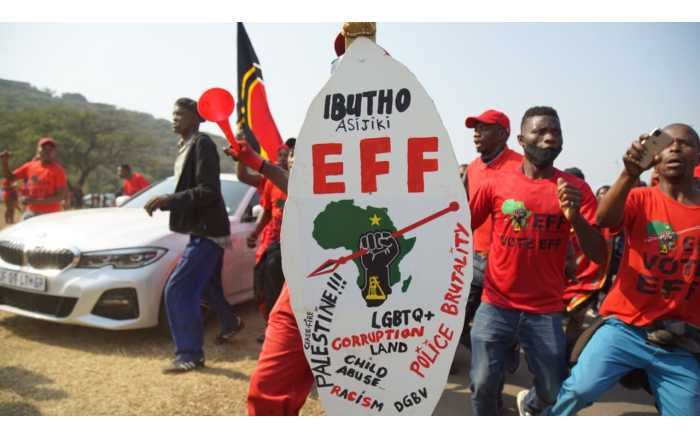 Scores of EFF members marched to the Phoenix police station on 5 August 2021 after at least 36 people were killed during July's civil unrest