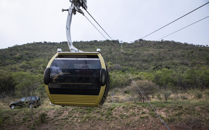 A cable-cart taking visitors to the mountain top restaurant in Euphoria Golf and Lifestyle estate.