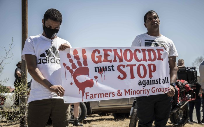Protesters from the farmers' organisation hold a placard against violence against farmers and minority groups. Picture: Abigail Javier/EWN