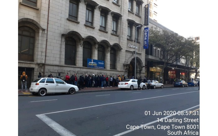 People queue at a liquor store in Cape Town.
