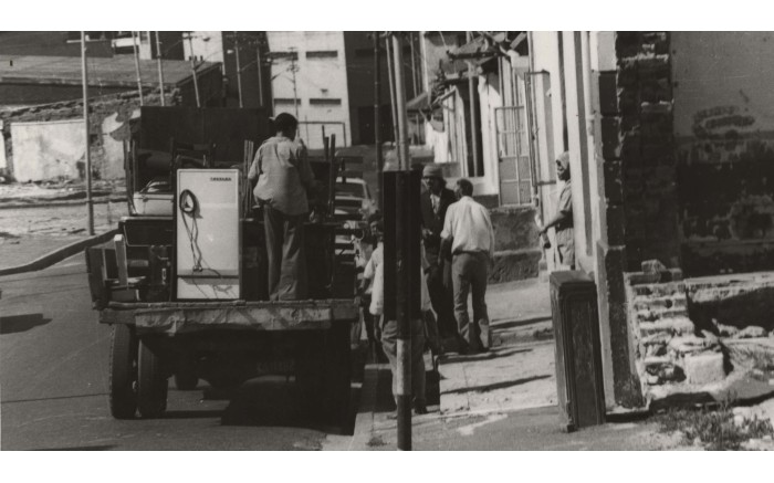 District Six residents load their possessions onto a truck. Picture: The District Six Museum