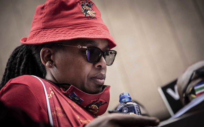 Cosatu President Zingiswa Losi signs the memorandum in Pretoria. Picture: Abigail Javier/EWN