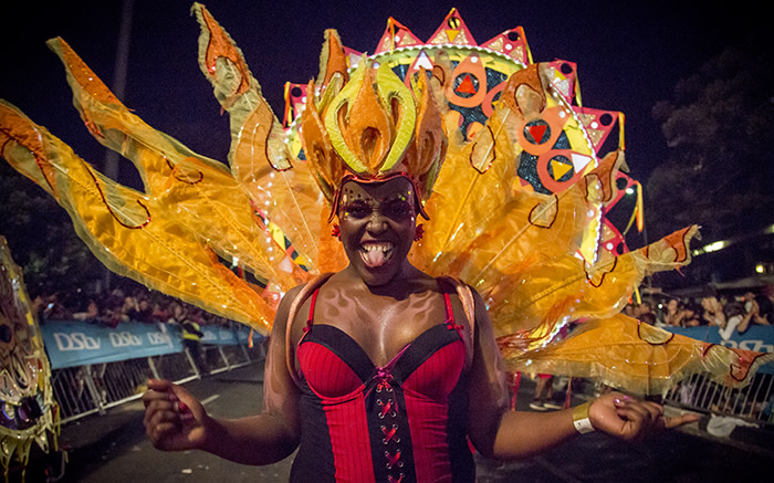 A fire queen struts her fiery stuff at the 2015 Cape Town Carnival. Picture: Thomas Holder/EWN