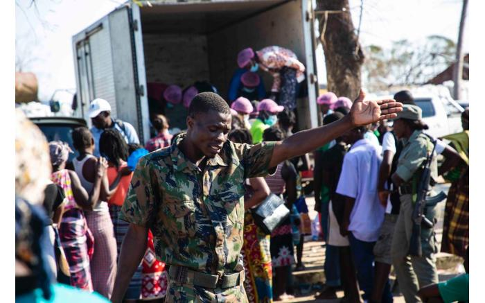 A member of the Mozambican government runs the line at the food truck in a relief camp set up for victims of Cyclone Idai. Ahmed Kajee/EWN