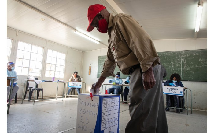 A voter placing their ballot paper inside a ballot box after casting their vote at Rantailane Secondary School.