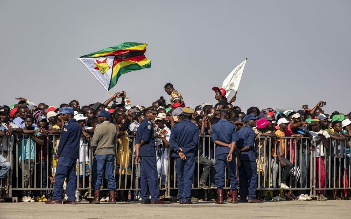 Supporters of the late Robert Mugabe gathered in their hundreds at the airport to receive his body.