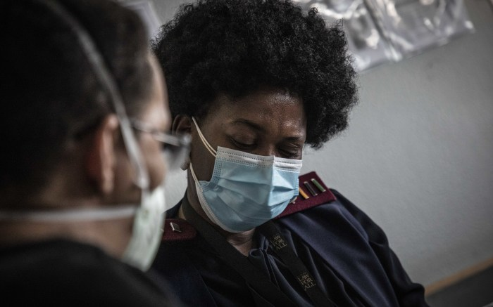 A vaccinator taking a healthcare worker's details ahead of vaccination at Steve Biko Hospital. Picture: Abigail Javier/EWN