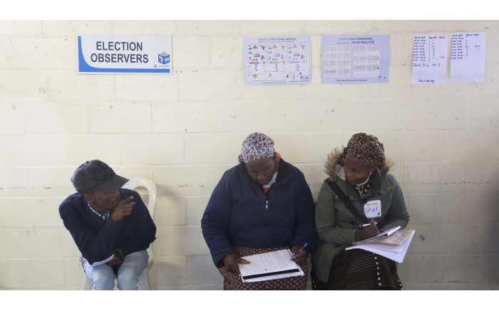 IEC Election observers sit on one side of the voting station counting the number of voters throughout the voting day. Picture: Bertram Malga