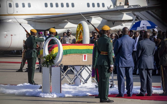 The coffin bearing the body of Robert Mugabe arrives on the strip at the Robert Mugabe International Airport.