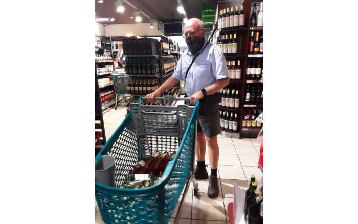 A shopper with his trolley of wine at the Shoprite in Shayandima in Thohoyandou in Limpopo.
