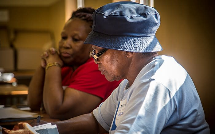 READY TO SERVE: An IEC volunteer waits to register voters at the Orlando West High School in Soweto. Picture: Reinart Toerien/EWN
