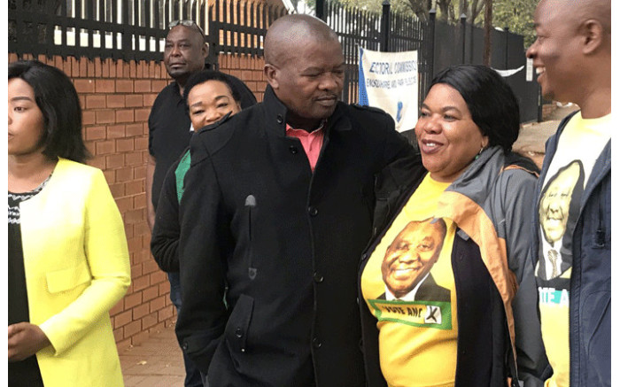 UDM leader Bantu Holomisa talks to ANC supporters at Arcadia Primary School to cast his vote. Picture: Barry Bateman/EWN