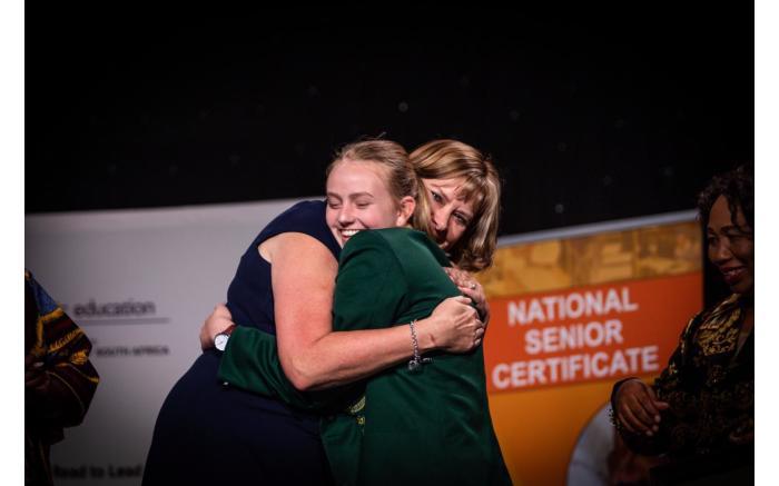 Western Cape Education MEC Debbie Schafer shares a hug with national top achiever Madeleine Dippenaar.