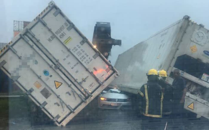 One person has been killed and another injured after shipping containers fell on a vehicle during the KZN storm. Picture: Arrive Alive.