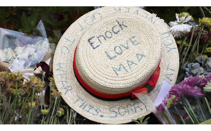 A Parktown Boys' hat lies among the wreaths. 'Sorry you never got the chance to wear this' is inscribed on it. Xanderleigh Dookey/EWN