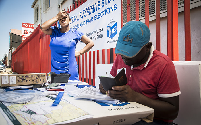An IEC official takes down the details of a new eligible voter registering in Denver near Johannesburg's CBD. Picture: Reinart Toerien/EWN