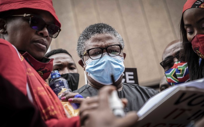 Transport Minister Fikile Mbalula receives the memorandum from the union leaders in Pretoria. Picture: Abigail Javier/EWN