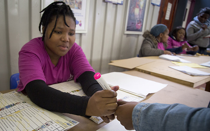 An IEC official marks a voter's finger in Imizamo Yethu, Hout Bay, on 3 August 2016. Picture: Aletta Harrison/EWN.