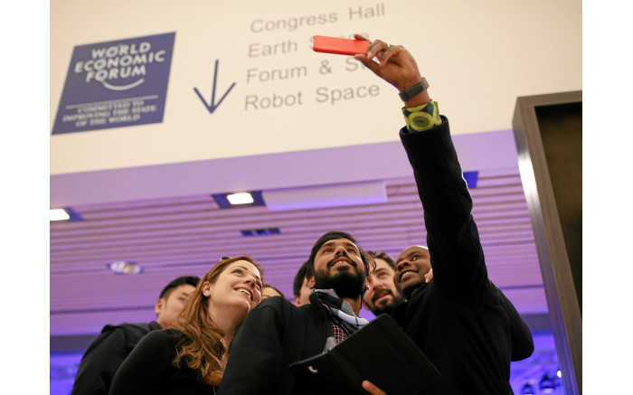 WE'RE HERE: Delegates take a selfie at the World Economic Forum's annual meeting in Davos. Picture: swiss-image.ch
