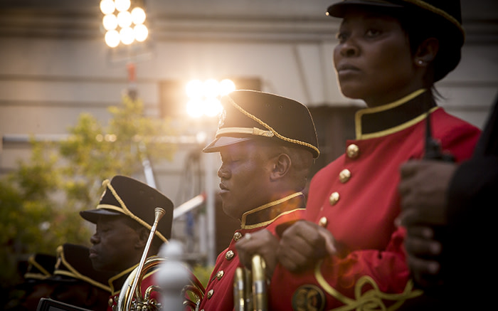 A band member rests his eyes while one another to his right does the same while waiting for President Jacob Zuma to arrive at Parliament for the State of the Nation Address. Picture: Thomas Holder/EWN