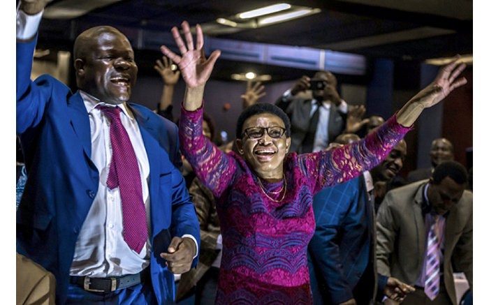 Joy from Zimbabwean MPs as they celebrate Mugabe's resignation. Picture: AFP.