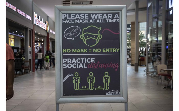 Multiple signs at Greenstone shopping centre reminding shoppers to observe Covid-19 health regulations.