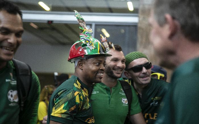 Bafana Bafana players and supporters at OR Tambo International Airport. Kayleen Morgan/EWN