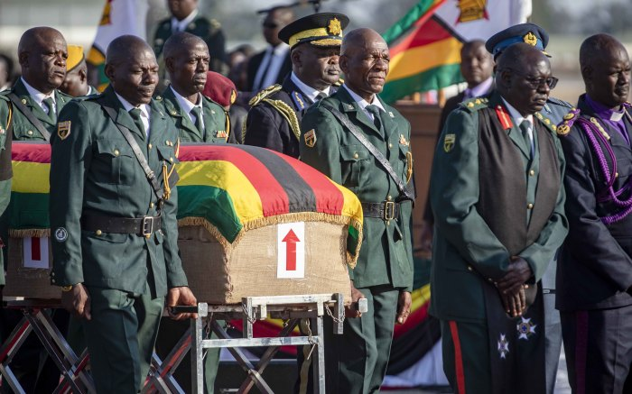 The coffin bearing the late Robert Mugabe is led by procession to the waiting hearse.