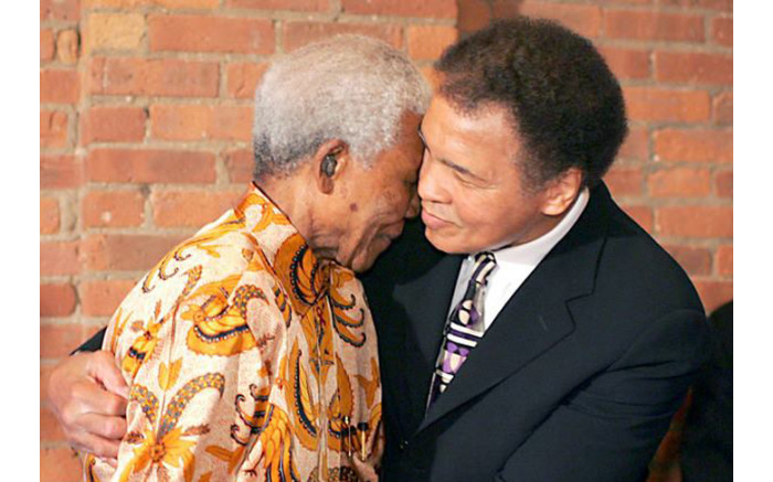 Former South African president Nelson Mandela enjoying a moment with Muhammad Ali.