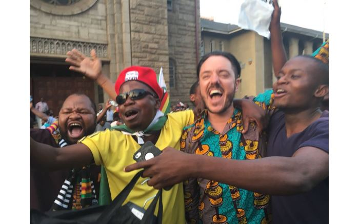 Big smiles and outpouring joy as crowds of people in Harare celebrate as Robert Mugabe's resignation. Picture: Ihsaan Haffajee/EWN.