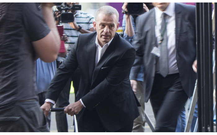 State Prosecutor Gerrie Nel arriving at the High Court in Pretoria ahead of Oscar Pistorius murder trial on 11 September 2014. Picture: Christa Eybers/EWN.