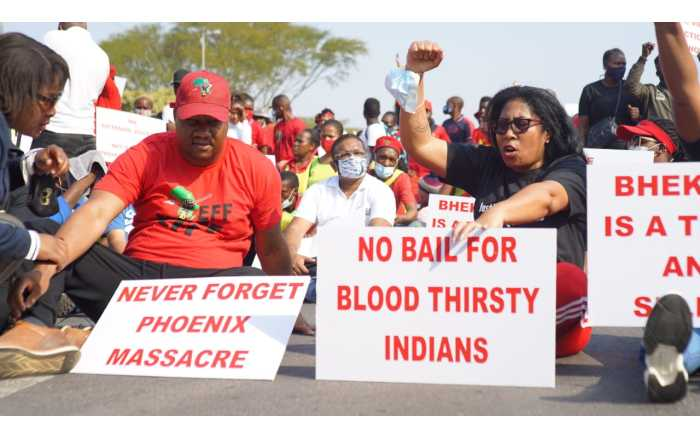 EFF members marched to Phoenix police station on 5 August 2021 after at least 36 people were killed during July's civil unrest.