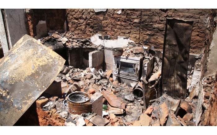 A burnt out kitchen in one of 53 house that were destroyed during the fire. Picture: Bertram Malgas/EWN