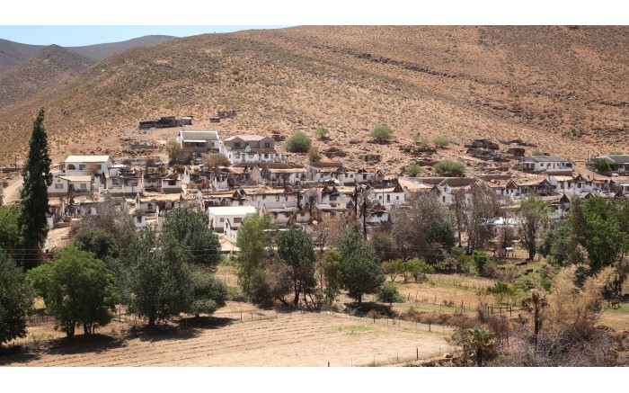 Rows of burnt out houses can be seen from the adjacent mountains. Picture: Bertram Malgas/EWN