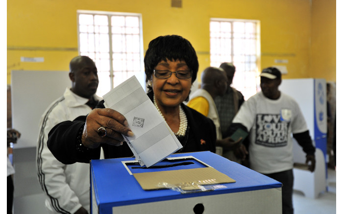 Winnie Madikizela-Mandela casts her vote in the South African local elections, in Soweto, on May 18,2011.